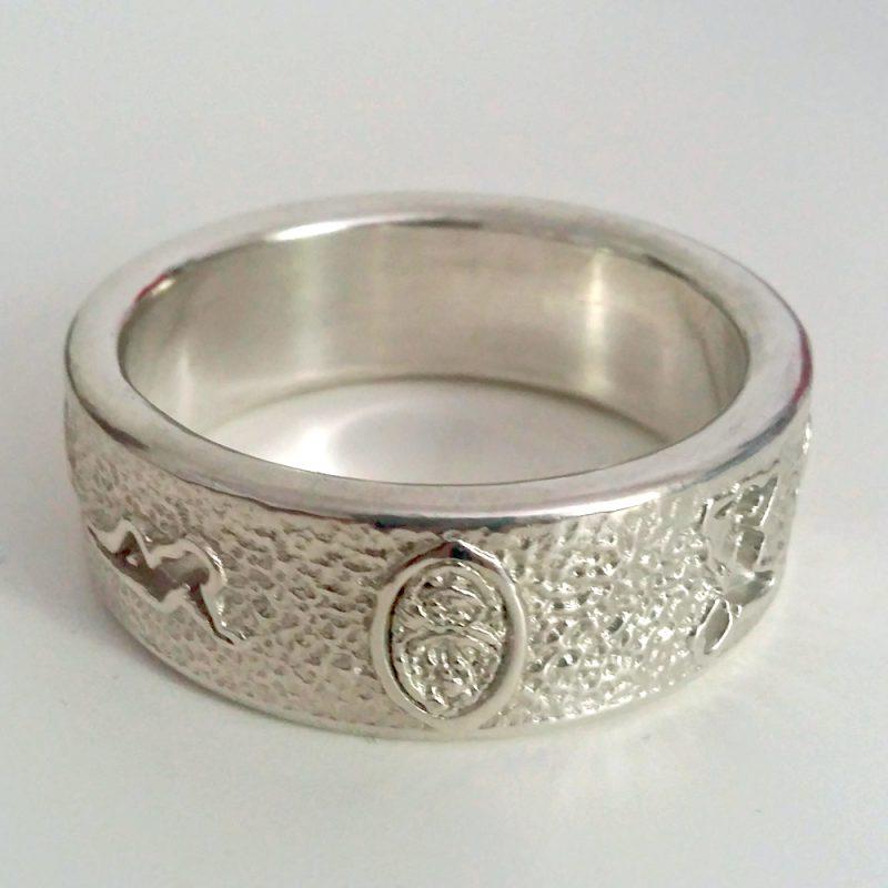 C-Ring mit Eros-Motiven - silber massiv